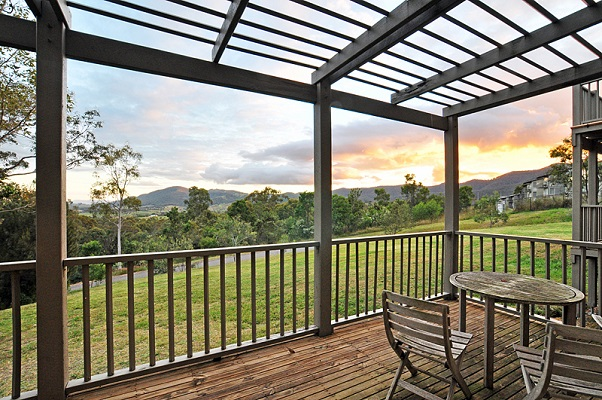 sunset view over the mountains from the private balcony on a cypress lake resort villa